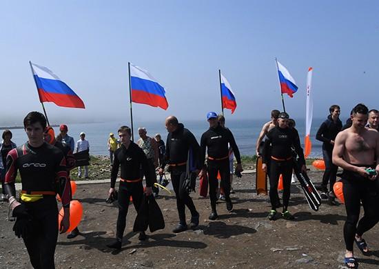 Участники заплыва